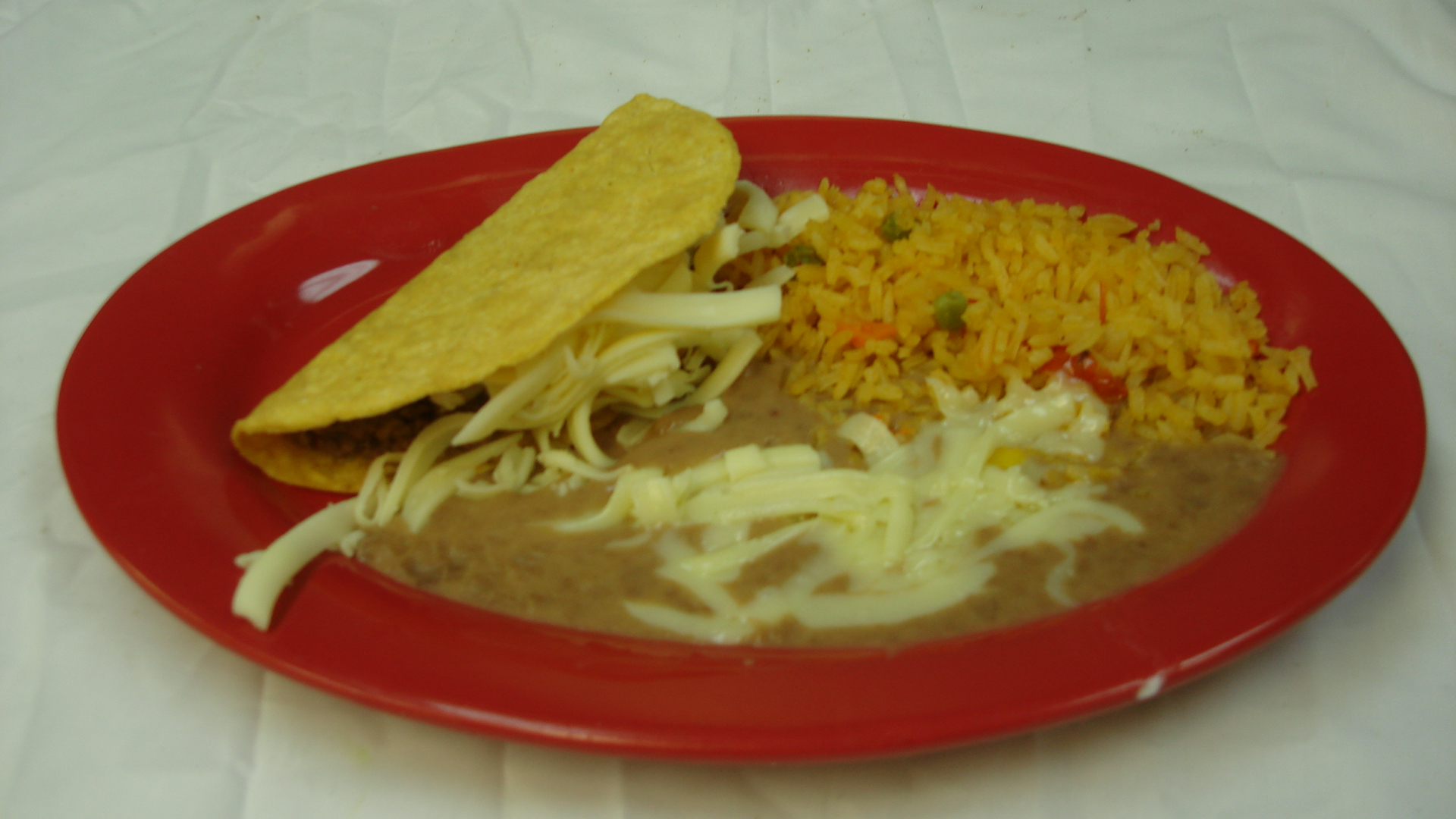 Taco - Served with rice and beans.